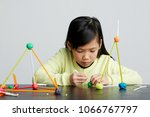 asian children play with straws.... | Shutterstock . vector #1066767797