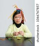asian children play with straws.... | Shutterstock . vector #1066767857