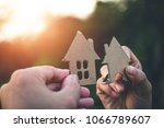house on the hand in nature ... | Shutterstock . vector #1066789607
