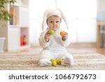 cute little baby in bunny... | Shutterstock . vector #1066792673