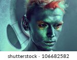 alien space man whith blue skin close-up portrait in studio - stock photo
