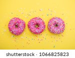 pink donut with sprinkles on... | Shutterstock . vector #1066825823
