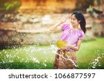 thai girl playing water in song ... | Shutterstock . vector #1066877597
