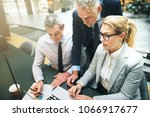 mature manager and two business ... | Shutterstock . vector #1066917677