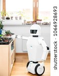 Small photo of autonomous robot is gardening indoors, robot gardener with vegetables in a room, cyborg is trying to understand the life