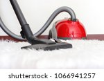 person cleaning carpet with... | Shutterstock . vector #1066941257