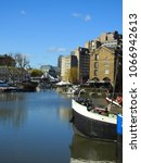 Small photo of March 2018: Photo of luxury boats docked in iconic Saint Katharine's dock near Tower Bridge on a sunny spring morning, London, United Kingdom