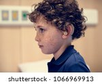 young boy with hearing aid | Shutterstock . vector #1066969913