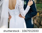 the bridegroom embraces the... | Shutterstock . vector #1067012033