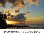 sunset over indian ocean  mahe  ... | Shutterstock . vector #1067071547