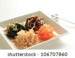 Korean cuisine, Namul Kimchi on white square dish - stock photo