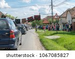 Small photo of TRANSYLVANIA REGION, ROMANIA - 10 JUNE, 2017: Romanian wedding tradition. Locals allowing cars to pass after groom and bride pays a symbolic sum of money