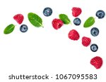 fresh  raspberries and... | Shutterstock . vector #1067095583