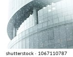 the office buildings in the rain | Shutterstock . vector #1067110787