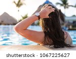 a woman in a swimming pool ... | Shutterstock . vector #1067225627