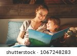 mother and child daughter... | Shutterstock . vector #1067248283