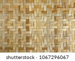 bamboo or straw weaving texture ... | Shutterstock . vector #1067296067