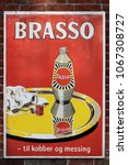 Small photo of Vejle, Denmark - November 12, 2015: Old style tin advertising board in danish for Brasso metal polish on a wall. Brasso is a metal polish designed to remove tarnish from brass, copper, chrome