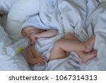 baby asleep feeding bottle | Shutterstock . vector #1067314313