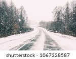 Small photo of Snow-covered Open Road During A Winter Snowstorm. Adverse Weather Conditions.