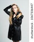 girl with long hair wears black ... | Shutterstock . vector #1067336447