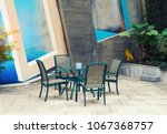 outdoor desk and chairs near... | Shutterstock . vector #1067368757