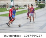Small photo of Havana, Cuba - July 2, 2013: A group of young men play a pick up game of soccer in Havana, Cuba. Soccer has seen an increase in popularity over the last decade on the island