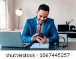 handsome businessman checking... | Shutterstock . vector #1067445257