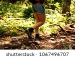 low angle view of female hiker... | Shutterstock . vector #1067496707