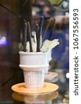 chocolate and sugar sticks in a ... | Shutterstock . vector #1067556593