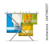 clothes rack with laundry.... | Shutterstock .eps vector #1067580257