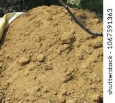 Small photo of a pile of dirt (sand, clay and silt) used on the infield of baseball diamonds has been uncovered for spring repairs; Harrisonburg, VA, USA