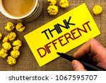 Small photo of Text sign showing Think Different. Conceptual photo Rethink Change on vision Acquire New Ideas Innovate written on Sticky Note Paper on the jute background Cup and Paper Balls next to it.
