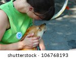 NEW YORK CITY - 1 JULY 2012: Adopt, a coalition of several animal rescue groups, hosts its first adoption fair in Tompkins Square Park. Display of honest affection on 1 July 2012 in New York City. - stock photo