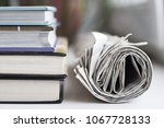rolled newspapers and pile of...   Shutterstock . vector #1067728133