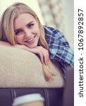 happy girl online browsing a...   Shutterstock . vector #1067892857