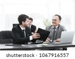 boss and employee discussing... | Shutterstock . vector #1067916557