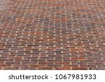 brick wall going up ... | Shutterstock . vector #1067981933