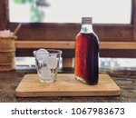 cold brew coffee bottle and ice ... | Shutterstock . vector #1067983673