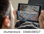 economy concept on a tablet | Shutterstock . vector #1068108527