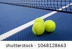 tennis balls on an indoor... | Shutterstock . vector #1068128663