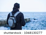 young man in the hood hat and...   Shutterstock . vector #1068130277
