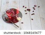 pink peony hot tea with white... | Shutterstock . vector #1068165677