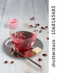 pink peony hot tea with white... | Shutterstock . vector #1068165683