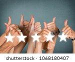 businessman showing hand sign...   Shutterstock . vector #1068180407