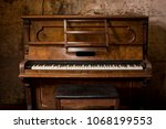 Old Wooden Piano Keys On Woode...