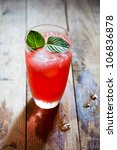 refreshing fruit punch beverage in glass on wooden background - stock photo