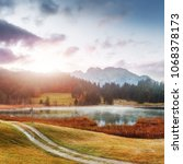 Small photo of Wonderful misty landscape at Germanian Alps. Colorful Clouds on Blue Sky over the Karwendel mountains at early morning in autumn, Bavaria, Germany. Awesome nature background. Geroldsee lake.