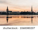 sunrise over city  riga  latvia ... | Shutterstock . vector #1068380207