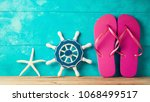 flip flops and starfish decor... | Shutterstock . vector #1068499517